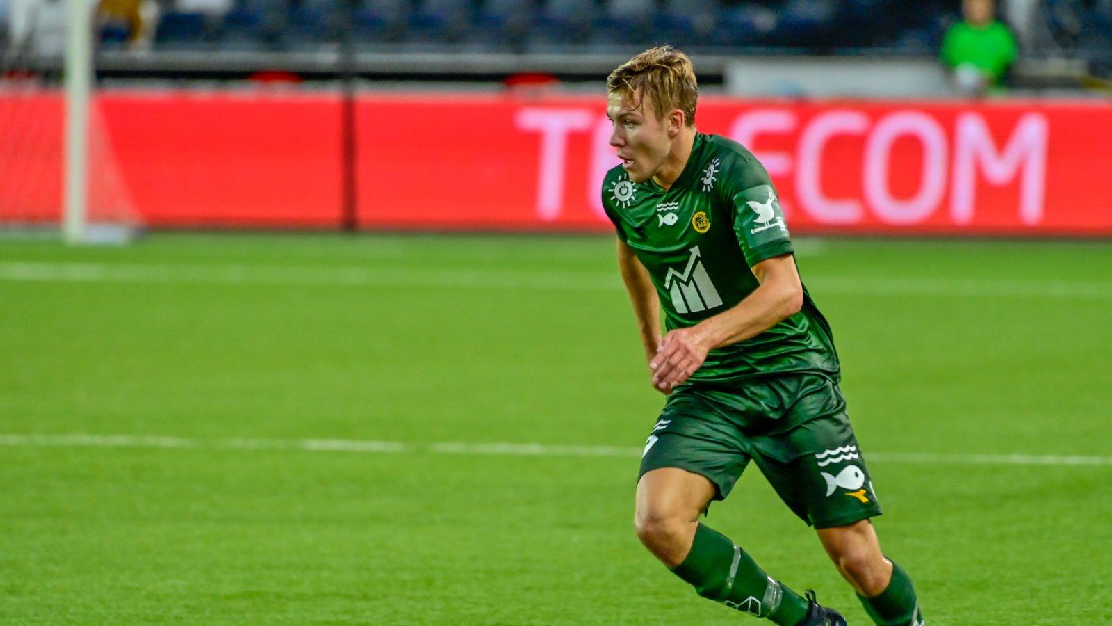 Fredrik André Bjørkan i den grønne bærekraftsdrakten i bortekampen mot Odd i 2019. Action Now.